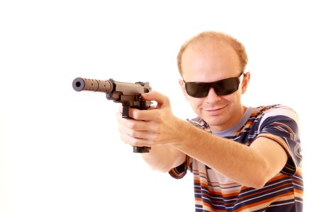 Young man aiming with gun isolated photo