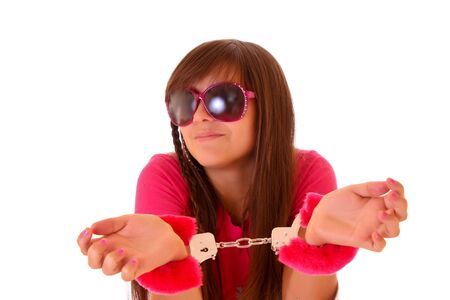 Cute young woman in handcuffs isolated on white Stock Photo - 6186130