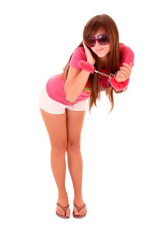 Cute young woman in handcuffs isolated on white photo