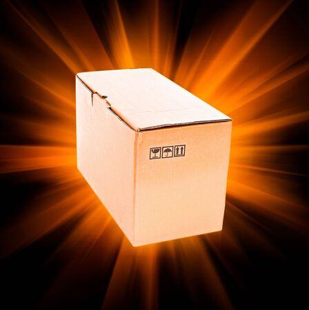 Cardboard box on black background with sun light photo