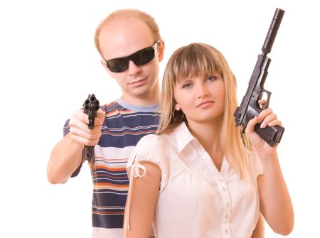 Man and woman with guns isolated on white photo