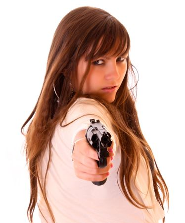 Young beautiful woman with revolver isolated on white photo