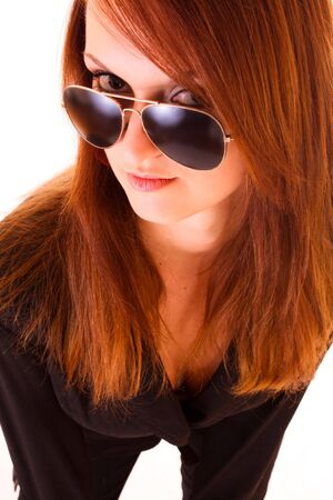 Young woman in sunglasses isolated on white photo