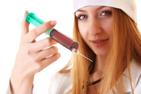 Young woman with syringe photo