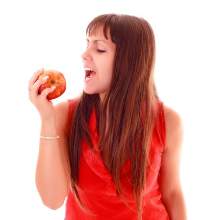 Young sexy woman eating apple isolated photo