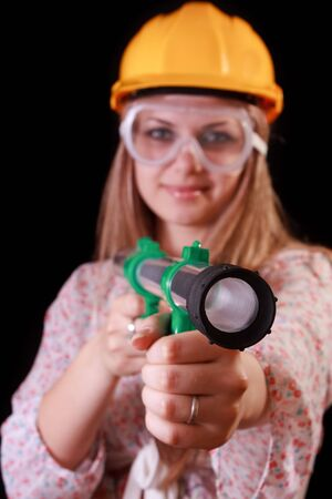 bazooka: Young woman in helmet with toy bazooka