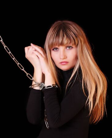 prisoner woman: Girl with chain on hands Stock Photo