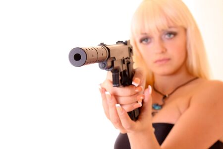 Young blond woman with gun isolated on white