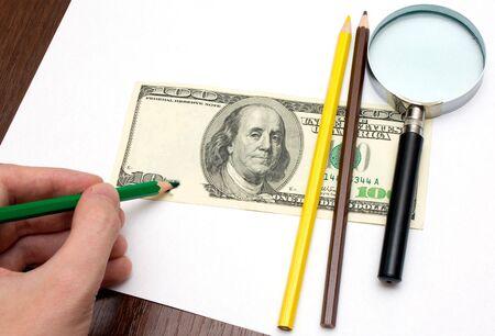 slump: Someone draw dollar by pencils Stock Photo