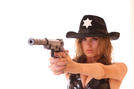 the silencer: Beautiful sheriff woman shooting with gun isolated on white