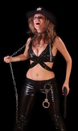 Beautiful sheriff woman on black background Stock Photo - 6278910