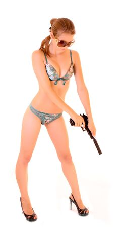 Beautiful woman in swimsuit reload gun isolated on white Stock Photo - 6287330