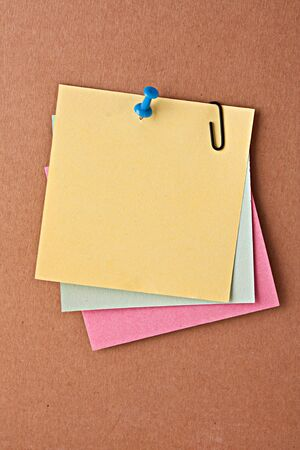 Three reminder notes  with pin on cardboard Stock Photo - 6267822
