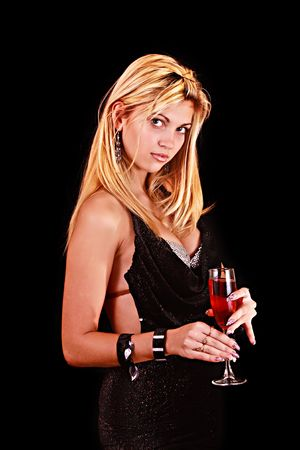 Beautiful woman with a glass of red wine on black background photo