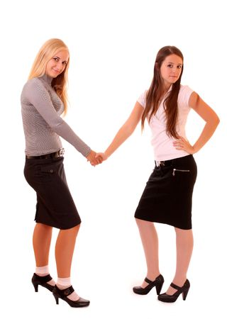 Two businesswomen shaking hands isolated on white photo