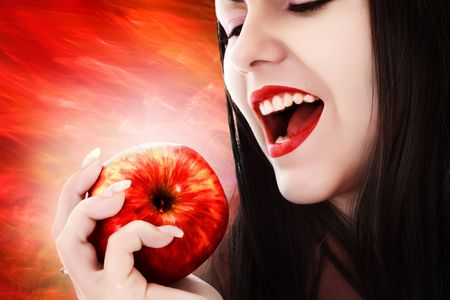 Young sexy woman eating apple photo