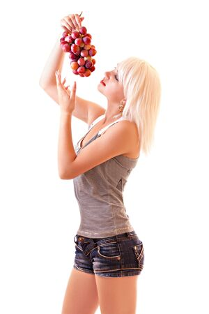 Young woman with red grapes isolated on white Stock Photo - 6580639