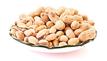 Few peanuts and dish isolated on white photo
