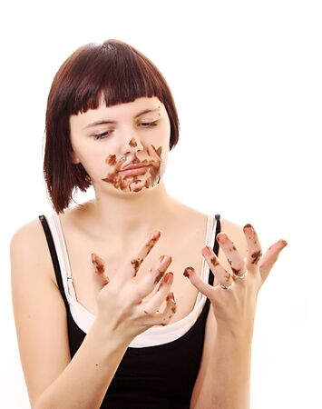 glutton: Young beautiful glutton eat chocolate isolated on white