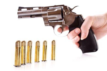 Vi�etas y rev�lver en mano. Pistola no real (m�s claro) Foto de archivo - 6840248
