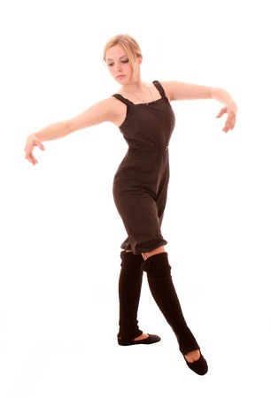 Young woman makes dancing exercise isolated on white photo