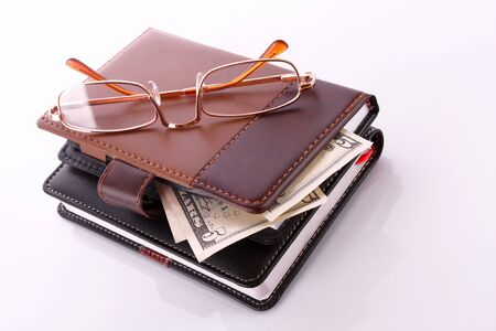 wallet: Glasses, purse and dollar banknotes
