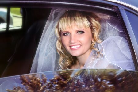 Beautiful bride in limousine photo