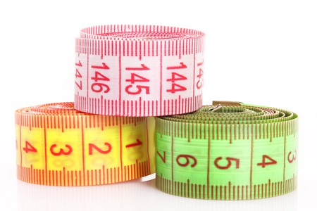 Multicoloured  measuring tapes  isolated on white photo