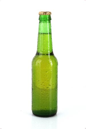 Green glass bottle with beer isolated on white photo