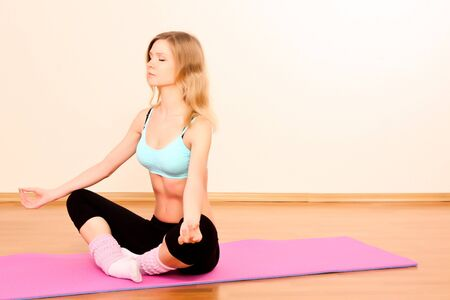 Young blond woman in lotus pose Stock Photo - 8155423