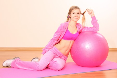 Woman with Exercise ball in gym photo