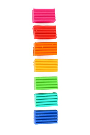 childen: Childen colour bright plasticine in the raw isolated on white