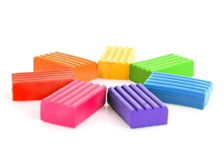 childen: Childen bright multicoloured plasticine  isolated on white