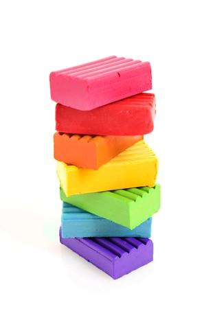 childen: Childen bright multicoloured plasticine in the column  isolated on white