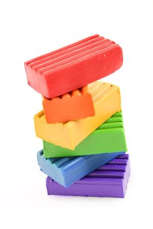 Childen bright multicoloured plasticine in the column  isolated on white Stock Photo - 7962797