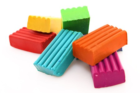 childen: Childen bright multicoloured plasticine set chaotically isolated on white Stock Photo
