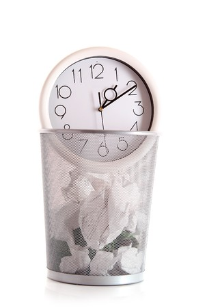 spent: Clock in trash, lost time concept Stock Photo