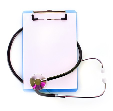 Stethoscope and blank clipboard isolated on white photo