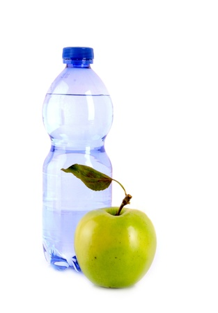 Bottle of sparkling water and green apple isolated on white photo