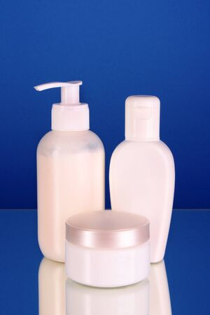 bottles of health and beauty products on blue background Stock Photo - 8282137