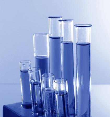 Test tubes on blue background Stock Photo - 8282515
