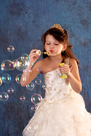 Little girl in white dress makes bubbles Stock Photo - 9784412