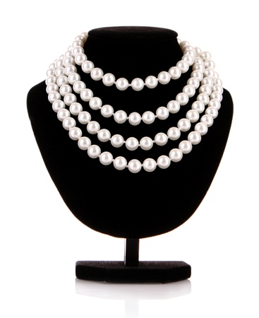 pearls: Pearl necklace on black mannequin isolated Stock Photo