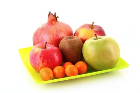 pomergranate: Pomergranate, kiwi, few apple and kumquat isolated on white