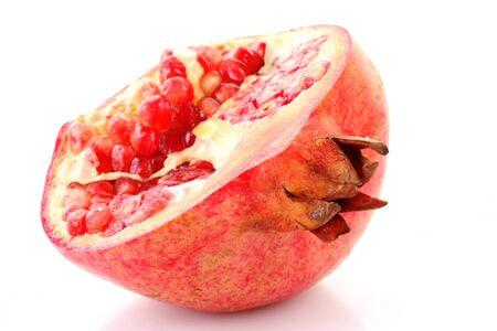 pomergranate: Piece of pomergranate isolated on white