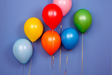 Flying balloons on blue background Stock Photo - 8641716