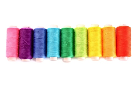 lurex: Pile of coloured bobbins of lurex thread isolated on white Stock Photo