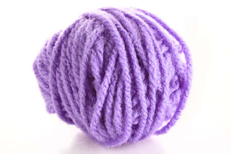 Purple ball of woollen red thread isolated on white photo
