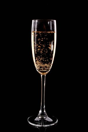 gold flute: Glass with champagne on black background