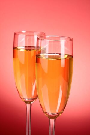 Glass with champagne on red Stock Photo - 8641466